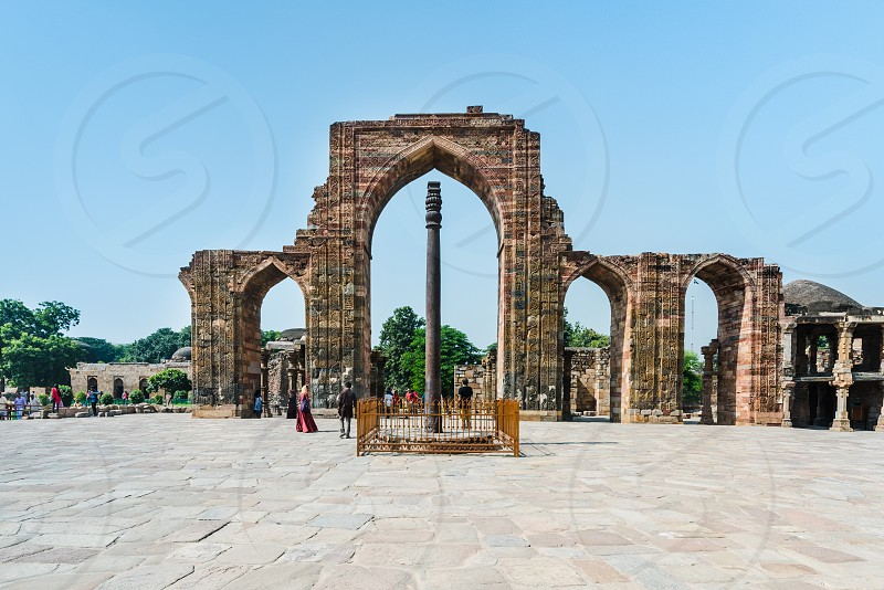 The iron pillar of Delhi is a 7 m kirti stambha originally erected and dedicated as dhvaja to Hindu deity lord Vishnu in 3rd to 4th century CE by king Chandra currently standing in the Qutub complex at Mehrauli in Delhi India photo