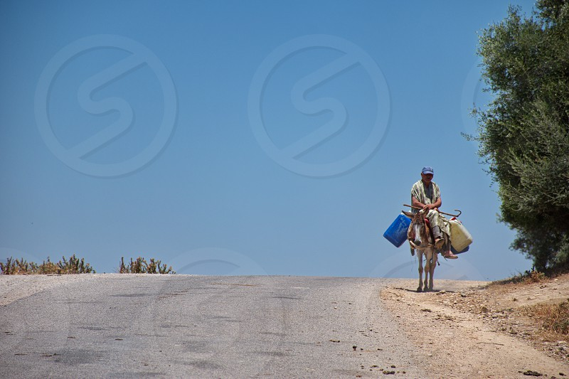 Old Berber riding mule in Morocco photo