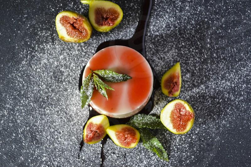 Panna cotta dessert with fresh fig fruits on dark background photo