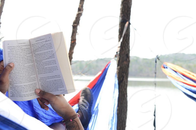 Person in hammock person reading a book. photo