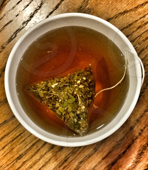 tea bag on cup of water photo