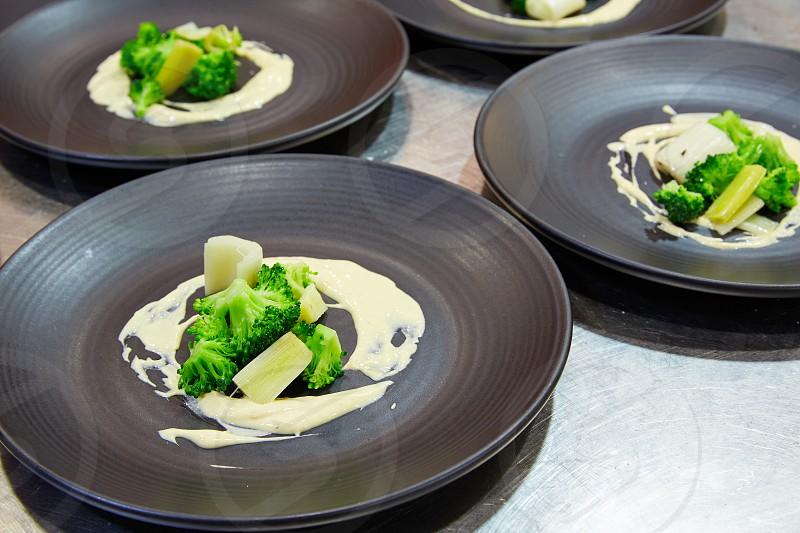 cuttlefish with prawn mayonnaise and broccoli photo