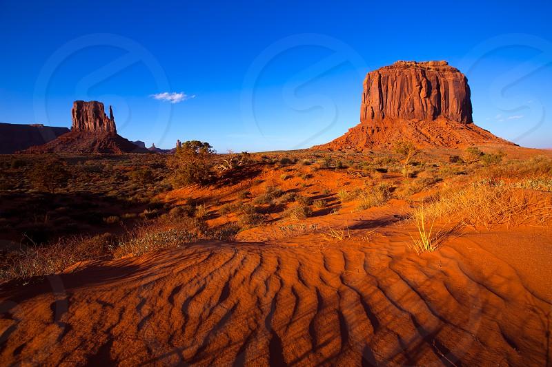 Monument Valley West Mitten and Merrick Butte desert sand dunes Utah photo