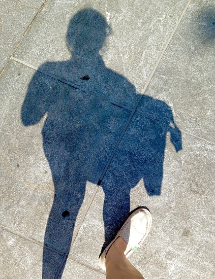 Shadow sidewalk urban pov photo