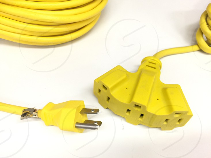 yellow power cord and 3 port power extension photo