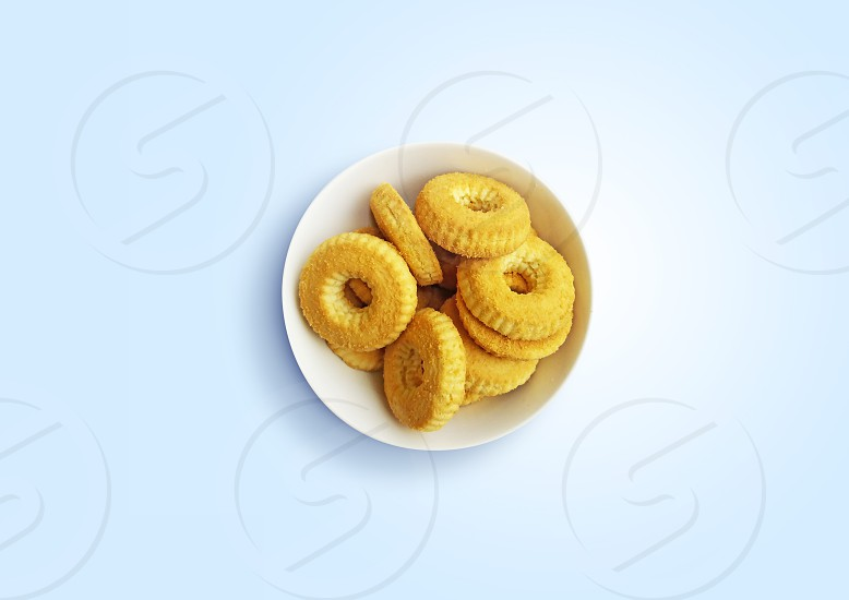Cookies on light blue background table top view photo