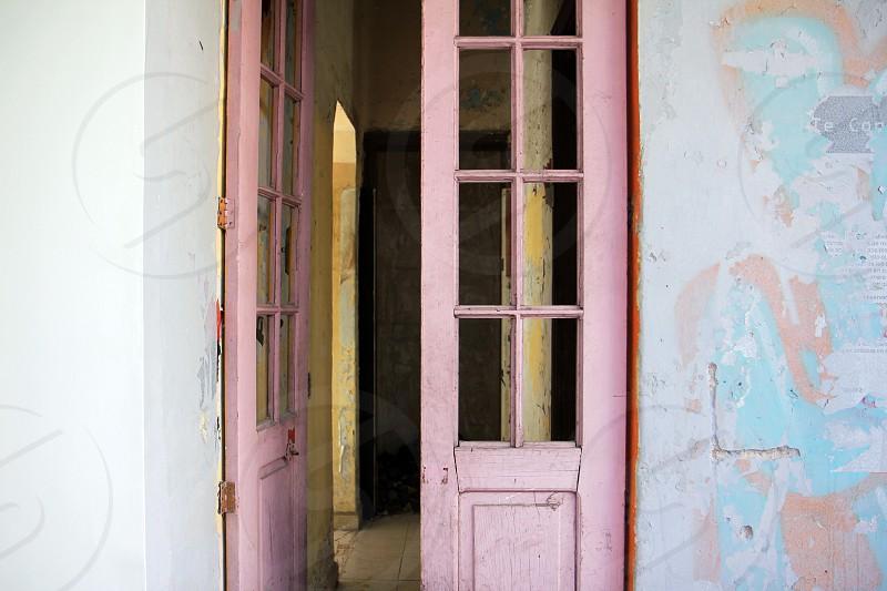needs paint renovation paint chipping fresh coat of paint open door pink door photo