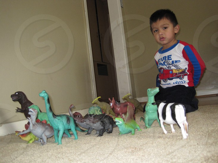 Playing with Dinosaurs photo