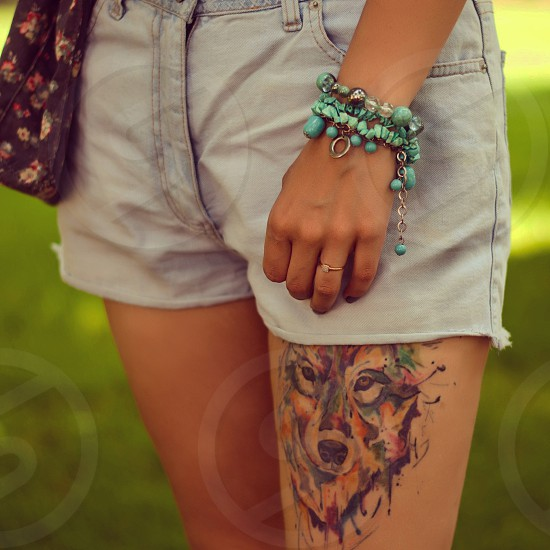 tattoo  ink  style  fashion  girl  drawing  wolf  watercolor  braslet  decoration  accessory  summer  denim  shorts  blue  green photo