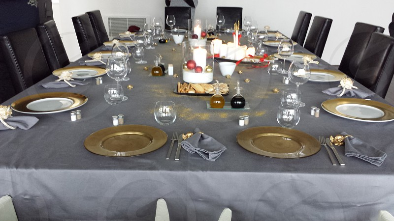 black leather dining chairs and organized formal table setting photo