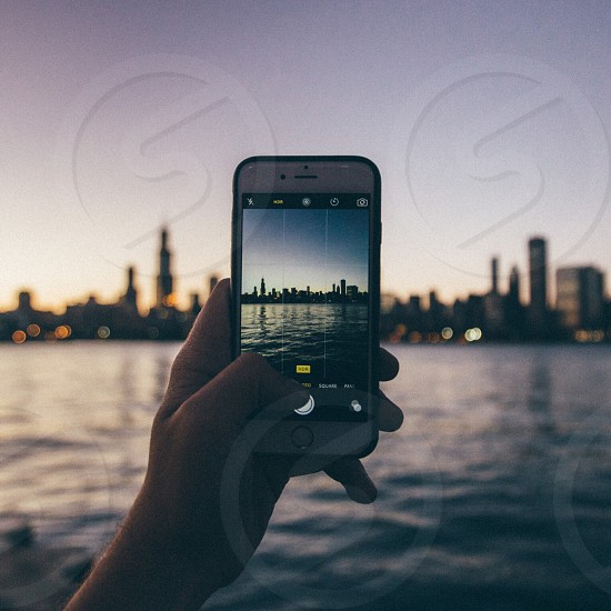 capturing the city view and the sea during sunset photo