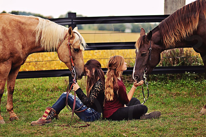 girls and their horses photo