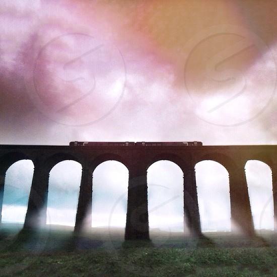 Foggy viaduct. Colourful warm sky photo