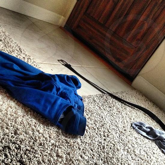 black leather belt on area rug photo