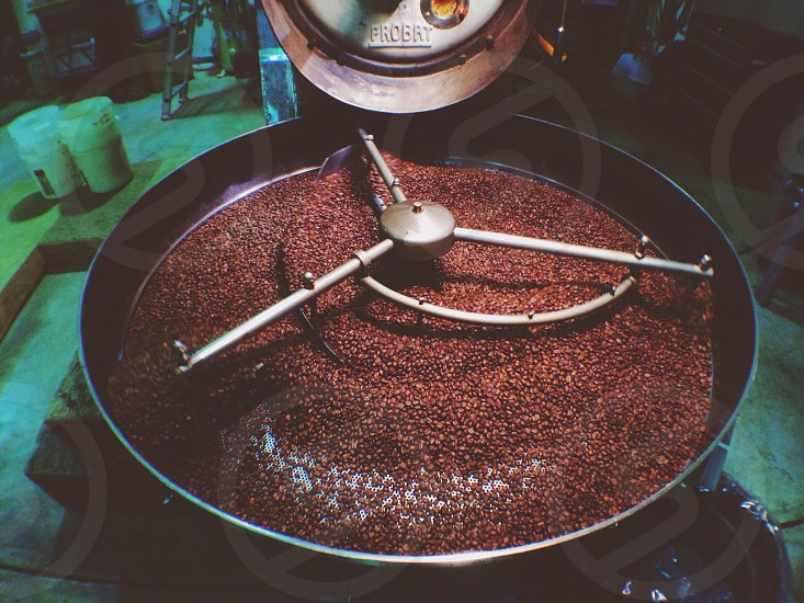 red beans on black factory grinder photo