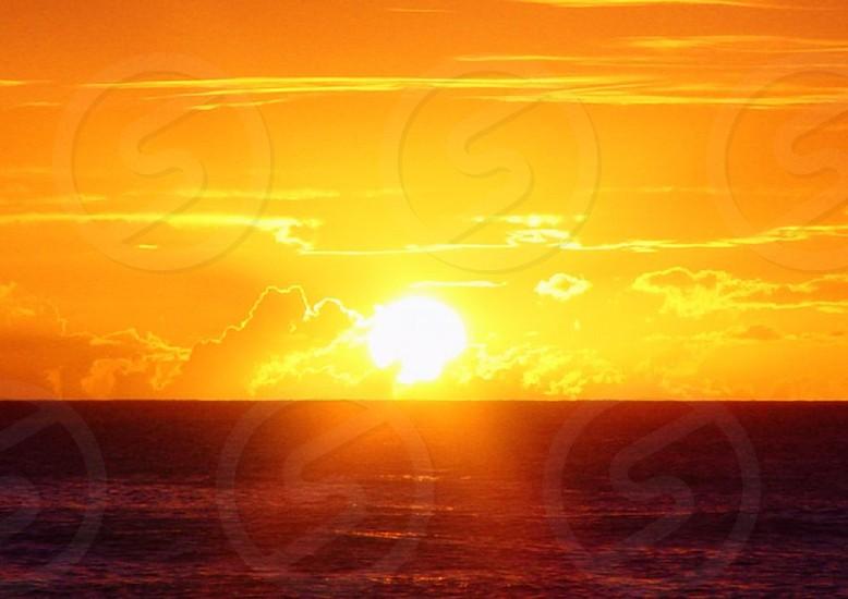 Sunset over Hawaiian waters photo