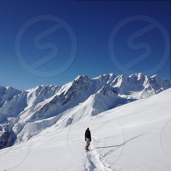 person on a snowy mountain top photo