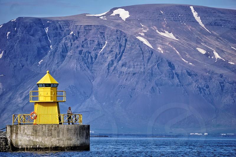 Icelandtravellighthousefishingmountainoceanseawater photo