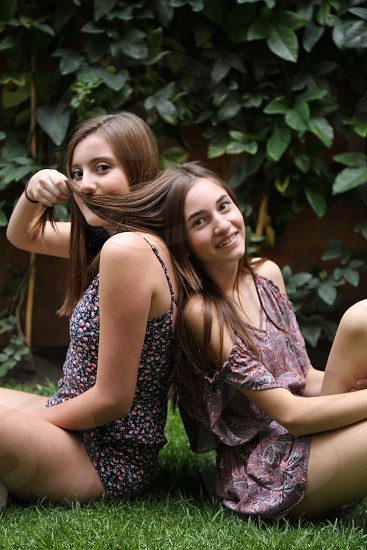 Girls happy playful brunettes boho bohemian style garden green seated lovely smiles summer photo