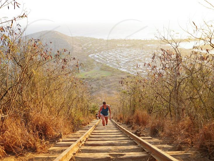 Fitness Climbing up a stairway railway up a mountain Oahu island Hawaii  photo