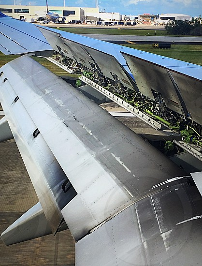 Safe landing - braking mechanisms on the wing of the airplane.  Safe landing runway airplane airport brake stop stopping wing mechanical cool interesting  photo