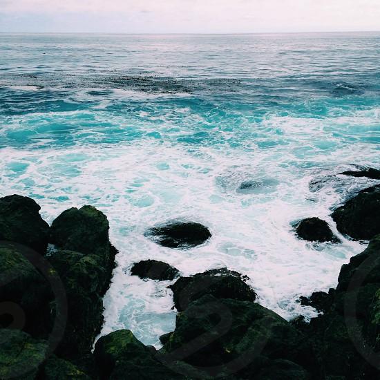 ocean wwaves and rocks photo