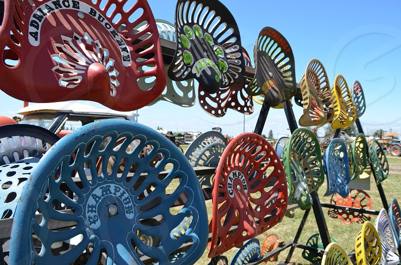 Rows of old tractor seats photo