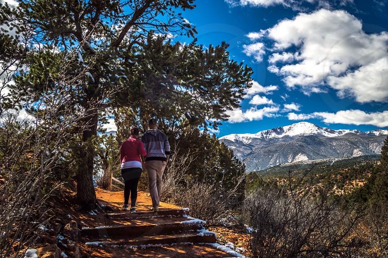 man and woman walking photo