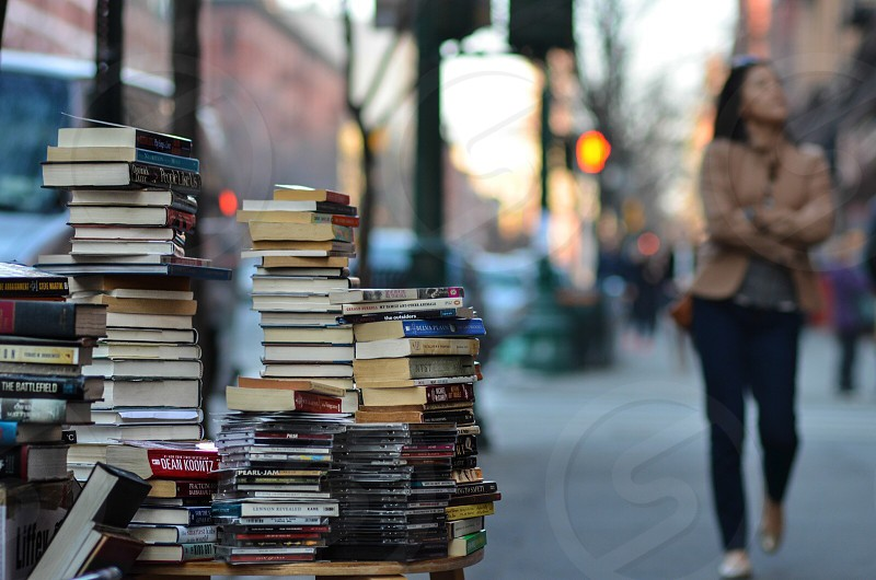 assorted books on brown wooden round table photo