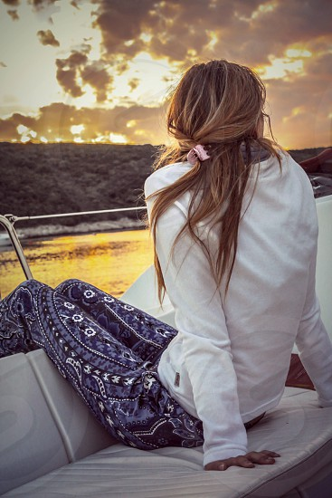 Girl sailing in the sunset sail away sailing girl sunset boat  sea photo