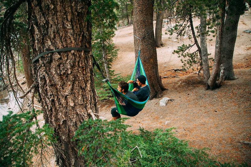 2 men on green hammock photo
