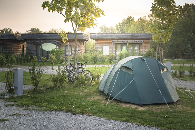 Tent and bikes on campsite in the morning. Sinrise photo