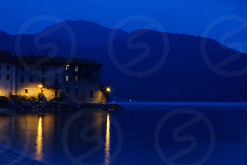 Night shot of houses on a lake and their reflection photo