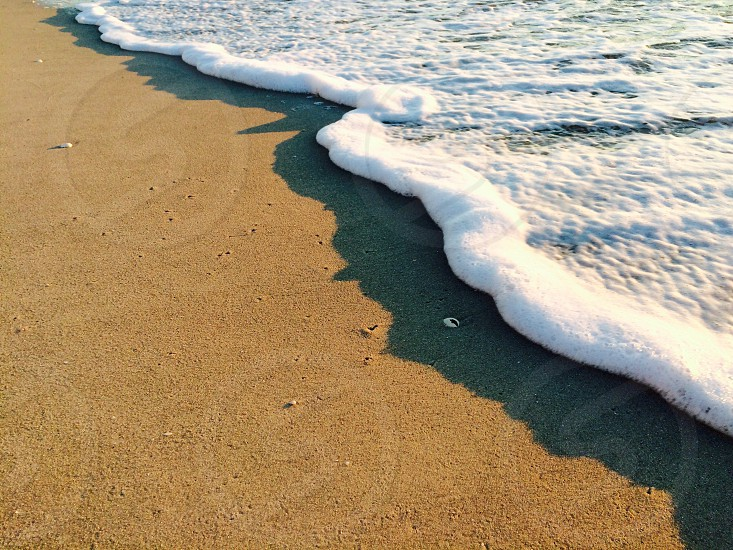 The surf line on a beach in Naples Florida. photo