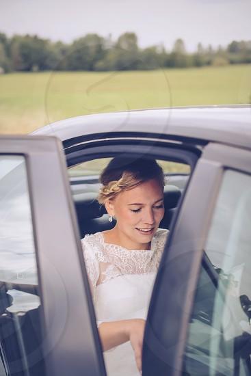 Transportation  bride dress apparel  car face beauty hairdo happy photo