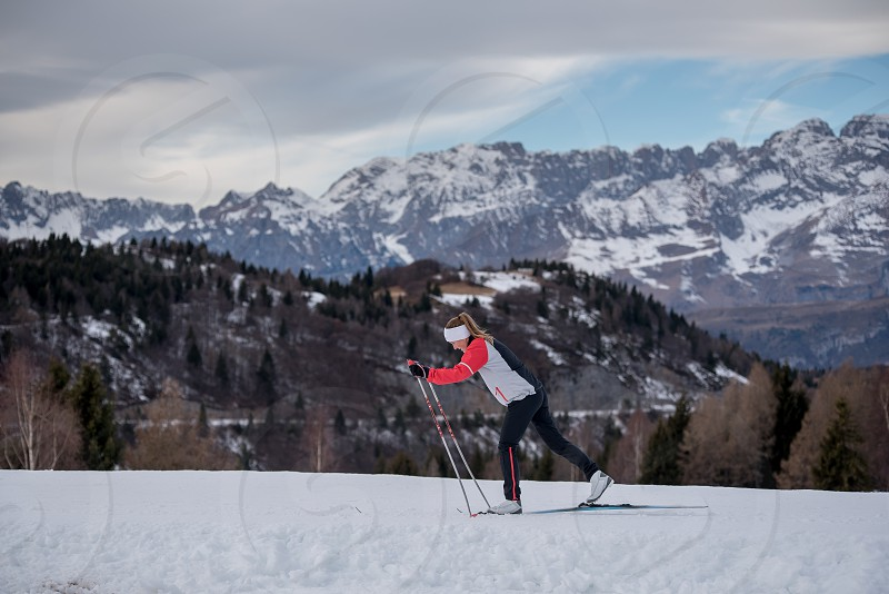 A skier descends a hill in the Italian mountains. photo