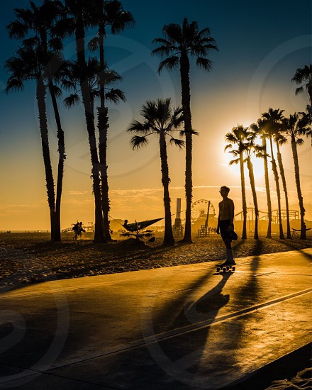 Silhouette sunset beach skateboard Southern California photo