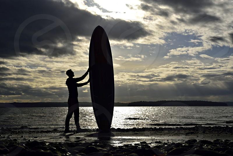 summer board paddle surf ocean sea lake sky sunrise sunset shore surfing surfer man silhouette photo