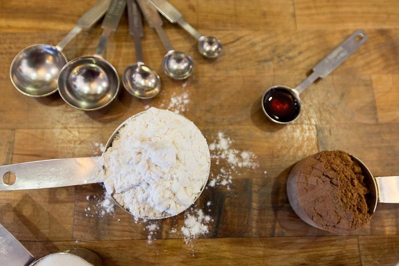 Women baking a cake in a kitchen photo