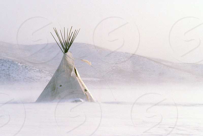 Sioux tepee during a snow storm on the South Dakota plains photo