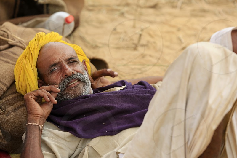 asian beards camel cattle commerce cultural cultural differences cultural diversity culture dealer desert down dress fair herder india indian indigenous lie livestock man market mela mustache people person portait pushkar rajasthan rural sand tourism trader traditional traditions travel tribal turban yellow photo