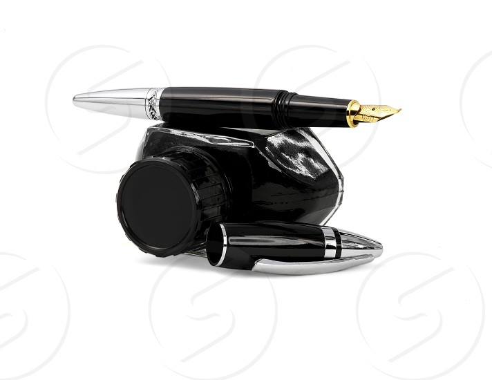 fountain pen and black ink bottle isolated on white background photo