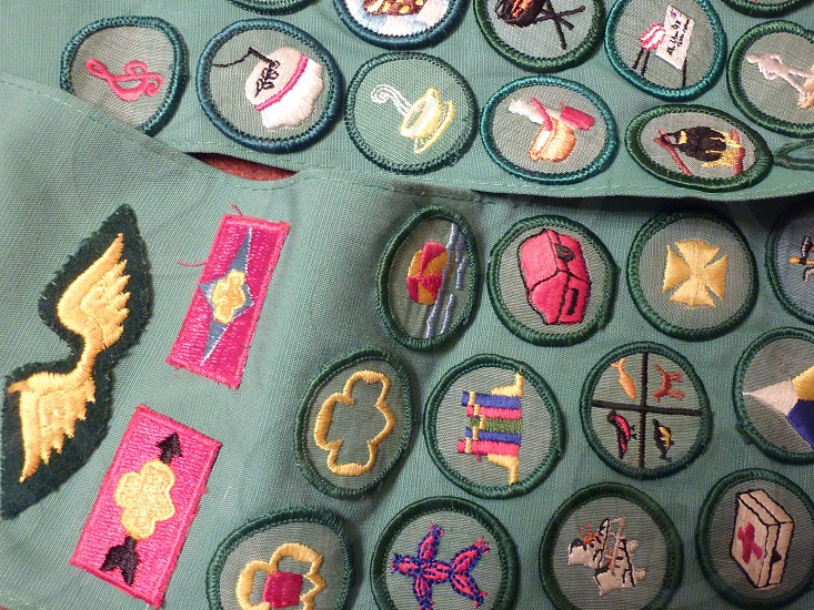 Girl Scout sash with badges photo
