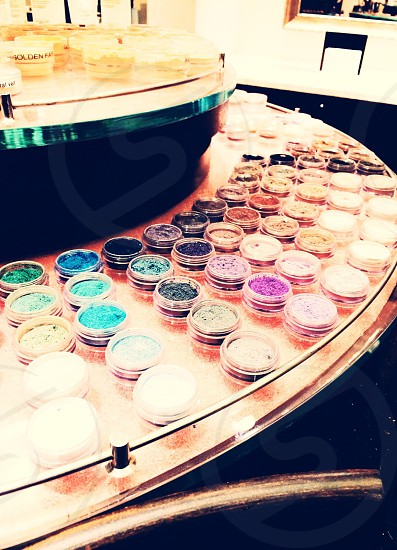 multicolored powders in round plastic container photo