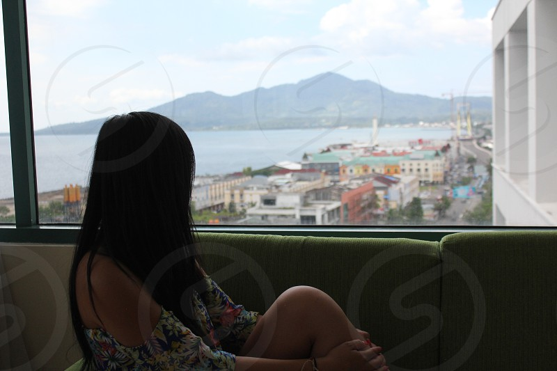 Enjoying the view in Indonesia. This city is Manado. Model is 23 years. photo