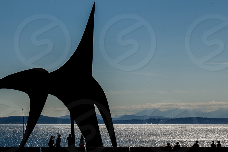 At a park on Seattle's waterfront people enjoy the outdoors amid architectural sculptures photo