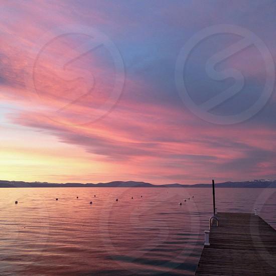 view od orange skies and lake photo