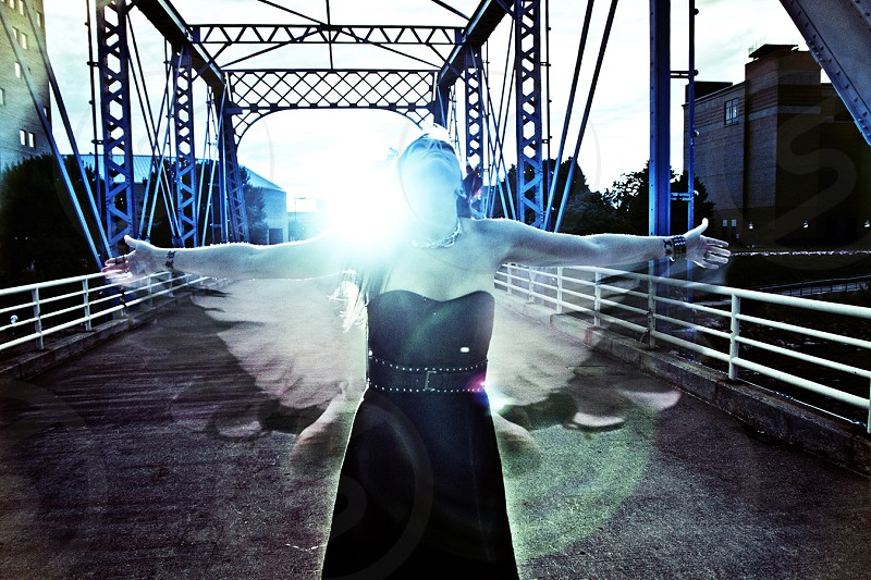 Return Flight - Ascending Flight Wings Transparent Bridge Blue Model Juxtaposition Girl with Wings photo