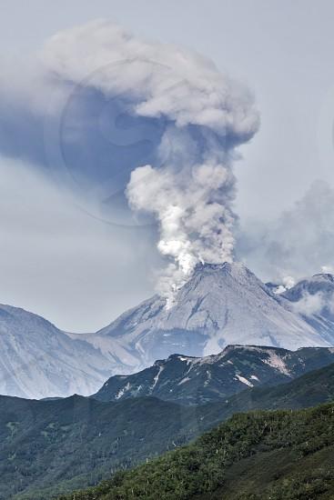 Beautiful mountain (volcanic) landscape of Kamchatka: view of erupting active Zhupanovsky Volcano on Kamchatka Peninsula - explosive-effusive eruptions gas-steam activity of volcano. Eurasia Russian Far East. photo
