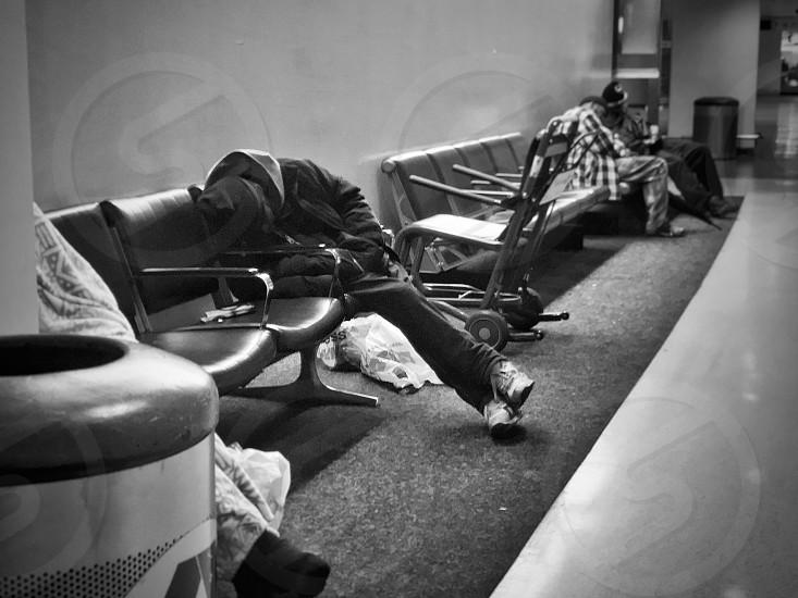 Homeless airport b&b life candid street editorial journalistic photo
